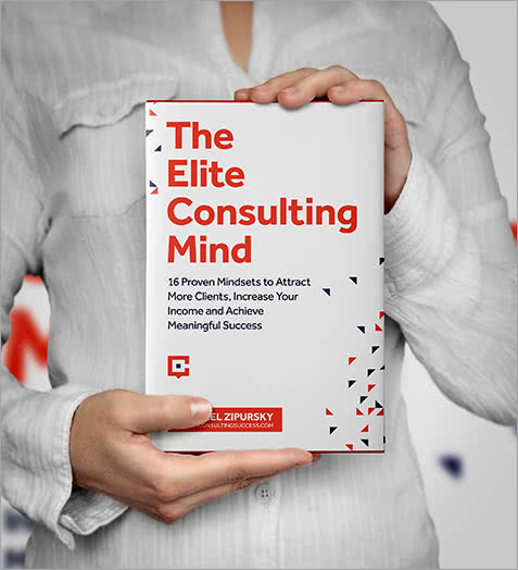 Person Holding the Elite Consulting Mind book