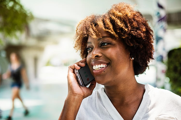 consultant talking on the phone with their prospect