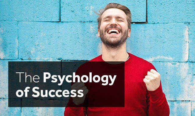 man is happy displaying the psychology of success